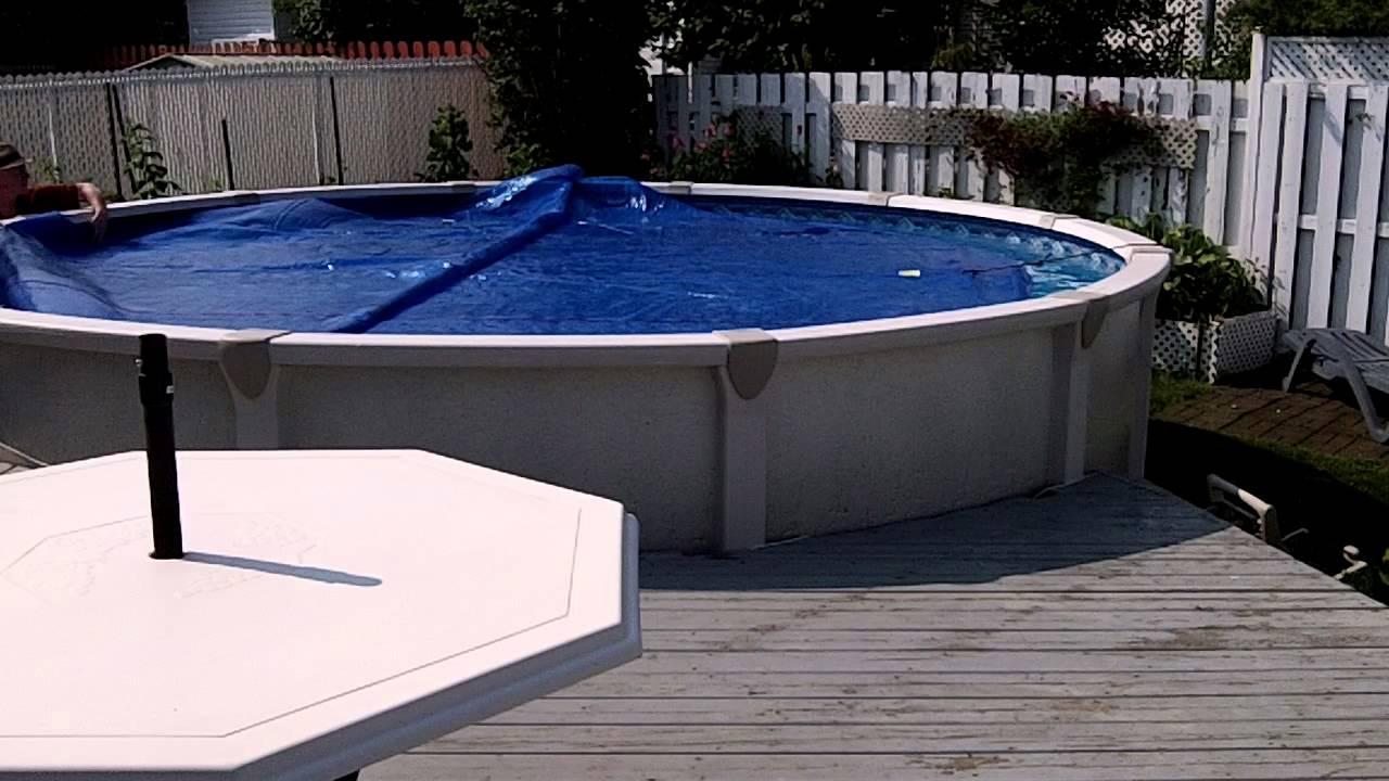 bache piscine quel sens